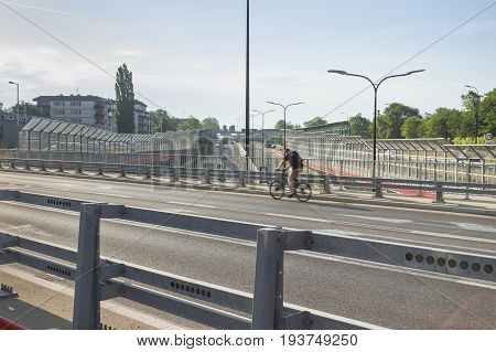 Central or diametral Higway (Drogowa Trasa Srednicowa) in Gliwice Poland morning cyclist passing by