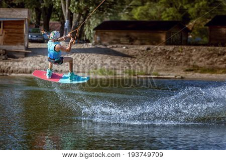 Jump over the water on a wakeboard an extreme sport.