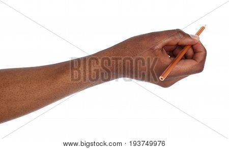 Dark-skinned hand holding black pencil. African american man writing or drawing, isolated on white background. Education, business, art concept