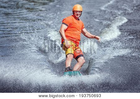 Surfing the waves on the wakeboard. Extreme sports.