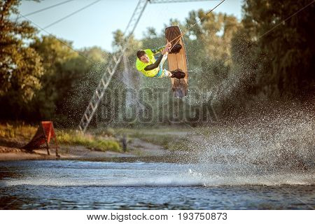 Jumping on a wakeboard on the water an extreme sport.