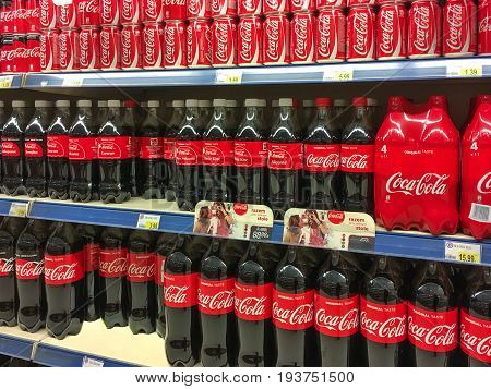 Nowy Sacz Poland - April 26 2017: Bottles of Coca-Cola drink from the Coca-Cola Company in a E.Leclerc Hypermarket.