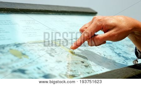 Jerusalem, Israel - May 21, 2017: Hands forefingers pointing the places on touristic map. Focusing on landmarks and trip planning.