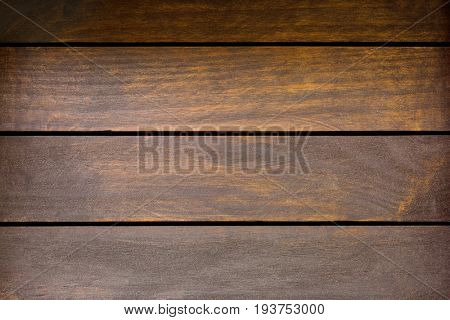 Texture of stained brown wooden background, old rustic wood planks on black background
