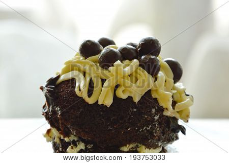chocolate cake topping vanilla cream and ball on plate