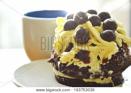 chocolate cake topping vanilla cream and ball with coffee