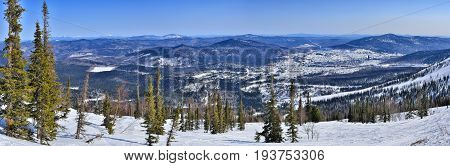 Spring landscape of ski resort Sheregesh Western Siberia Russia - panoramic view of the mountains