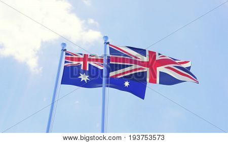 Australia and Great Britain, two flags waving against blue sky. 3d image