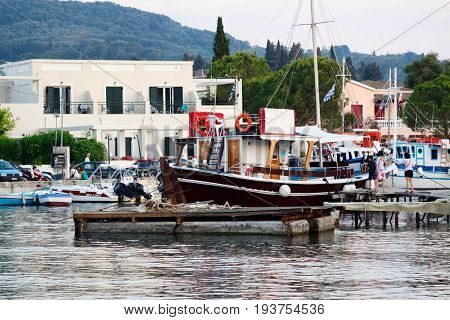 CORFU ISLAND, GREECE - JUNE 26, 2017: Pegasus Cruises company advertisement at coast of port in Greece, Corfu island