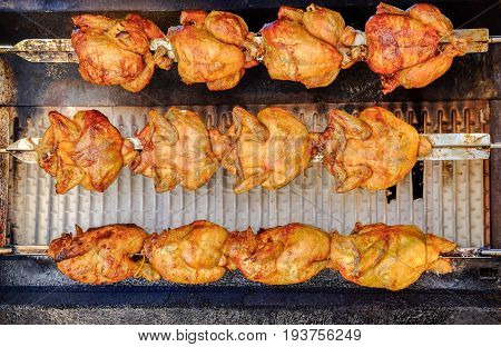 Rotisserie chicken on the grill at local street market
