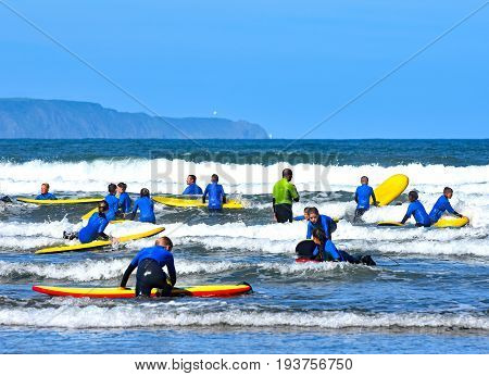 westward ho! Devon England - 2 July 2017 Teams of young people in the surf at Westward Ho!. being trained in how to surf safely.