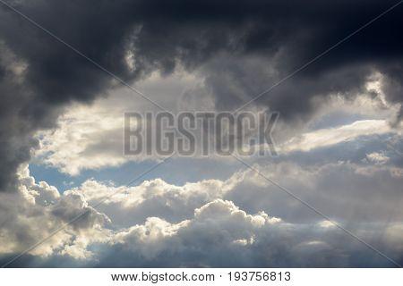 a big heavy and fluffy cumulonimbus cloud in the blue sky