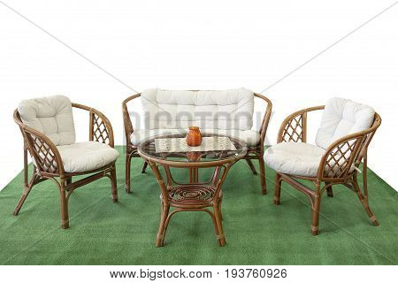 Set Of Garden Furniture From Rattan With Pillows On Artificial Grass
