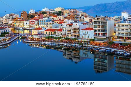Agios Nikolaos at night. Crete, Greece. Agios Nikolaos is a picturesque town in the eastern part of the island Crete built on the northwest side of the peaceful bay of Mirabello.