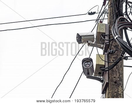 Closed circuit television on electric pole on white background