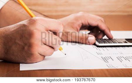 Calculator data analysis analysis businessman closeup business analysis financial analysis