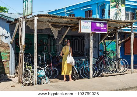 Toamasina Madagascar - December 22 2017: Woman looking for bicycle in Bicycle shop in Toamasina (Tamatave) Madagascar East Africa.