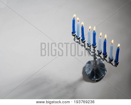 The Hanukkah menorah traditional candle holder for nine candles for Jewish holiday of Hanukkah on light background