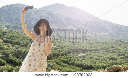 Woman Traveler Photographing Beautiful Natural View Mountains On The Island Of Crete. Concept - Tour
