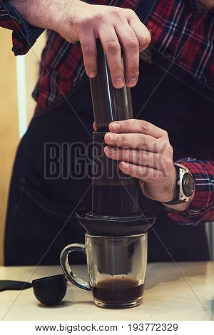 Brewing coffee in aeropress in the cafe
