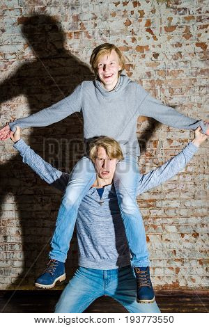 Two Brothers Posing In Studio, Teenage Casual Style