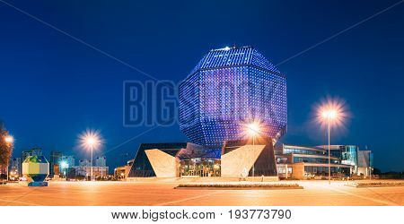 Minsk, Belarus - August 28, 2016: View Of Pedestrian Zone To National Library Building In Evening LED Illumination Blue Sky Background. Famous Hi-Tech Landmark, Cultural Informational Science Center.