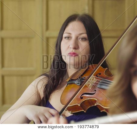 Close up portrait of portrait of two women playing music