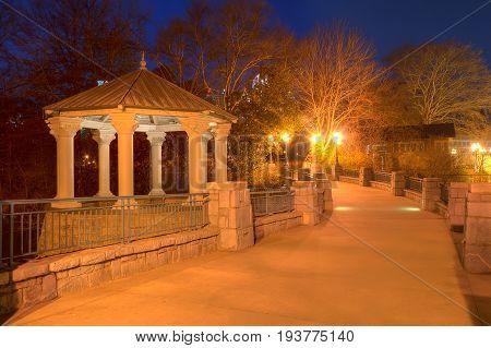 Night view of illuminated Clara Meer Gazebo and the bridge over the lake in the Piedmont Park Atlanta USA