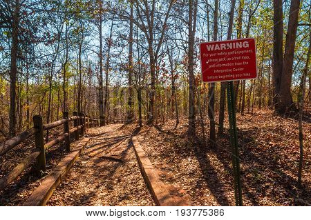 The footpath with fence and thicket in the Providence Canyon State Park in sunny autumn day Georgia USA