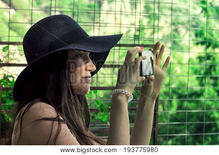 Female Traveler Photographing On Smartphone Beautiful Natural Views Of The Sea And The Mountains On