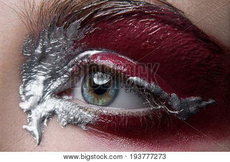 Macro And Close-up Creative Make-up Theme: Beautiful Female Eye With Silver And Red Paint, Retouched