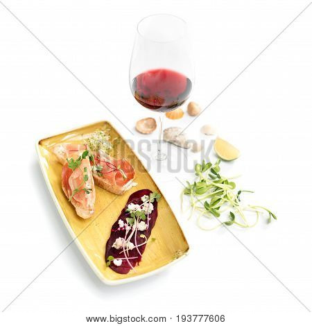 Bruschetta with Parma Ham and wine. Microgreens on roasted red beets and feta cheese. Micro greens, diet and healthy food