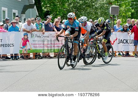 STILLWATER, MINNESOTA - JUNE 18, 2017: Three cyclists on course at the 2017 North Star Grand Prix Men's Stillwater Criterium. It is the final stage of a six-stage annual race event.