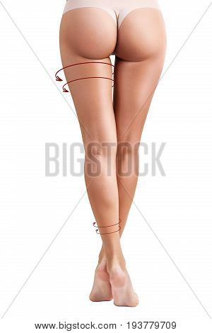 Sporty female legs with arrows shows tightening effect. Slimming concept.