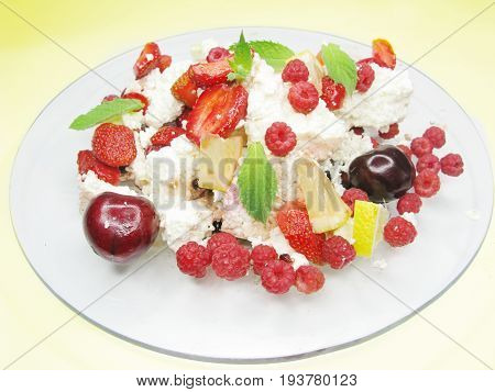 fruit salad with curd strawberry cherry rspberry and other fruits