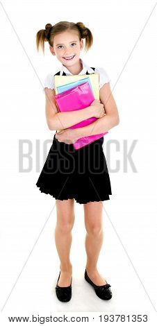 Portrait of smiling happy school girl child with books in uniform isolated on a white background