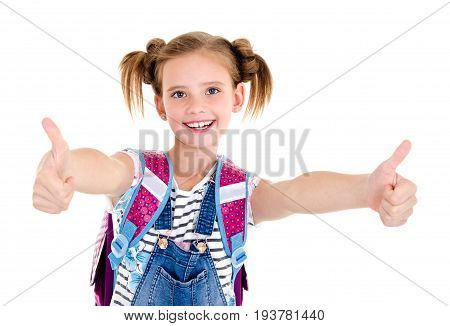 Portrait of smiling happy school girl child with school bag and two fingers up isolated on a white background education concept