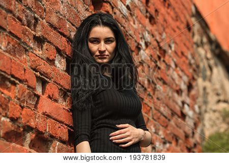 Portrait Of Young Beautiful White Girl With Aristocratic Features With Long Black Hair And In Black