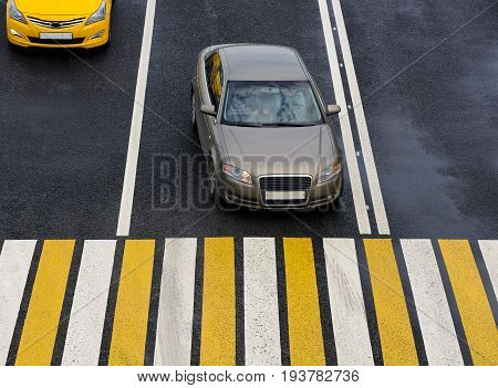 Car stopped at the zebra crossing. Crosswalk on a asphalt road