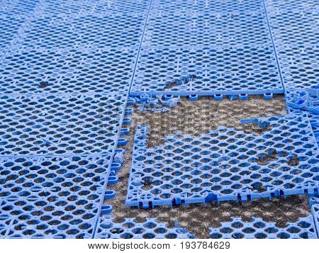 Football Field Made Of Plastic. And There Is A Fracture