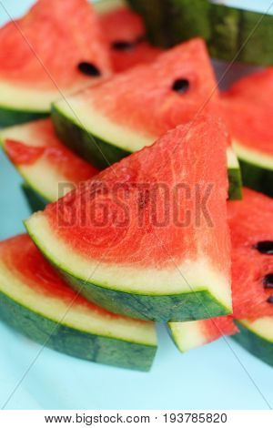 Fresh watermelon sliced is delicious on dis