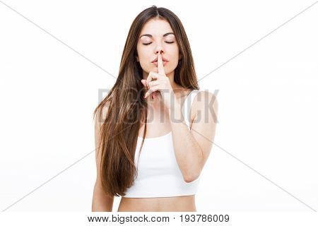Beautiful Young Woman Asking To Keep Quiet Over White Background.