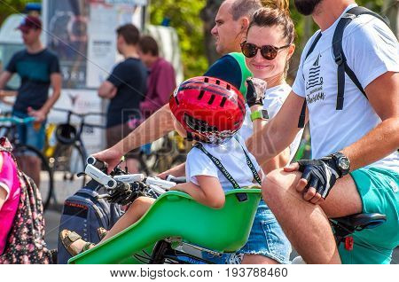 Ukraine Nikolaev 24.06.2017: Family: father mother and child before the start of the city bicycle parade dedicated to the Day of Youth.