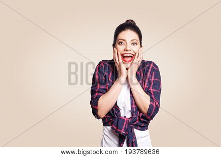People happiness and success concept. Beautiful girl screaming with amazement and joy gesturing with her hands while passing final exams with excellent marks. Body language.
