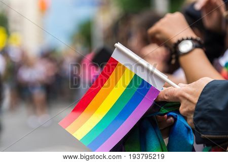 Gay Pride Parade Spectator Holding Small Gay Rainbow Flag During Toronto Pride Parade In 2017