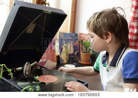 Boy playing with gramophone in a museum