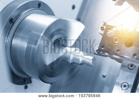 CNC lathe machine (Turning machine) cutting the metal screw thread part .Hi-precision CNC machining concept.