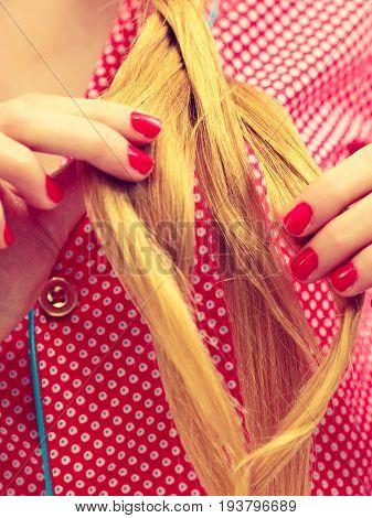 Closeup Of Woman Doing Braid On Blonde Hair