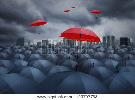 red umbrella outstanding from the others grey umbrella