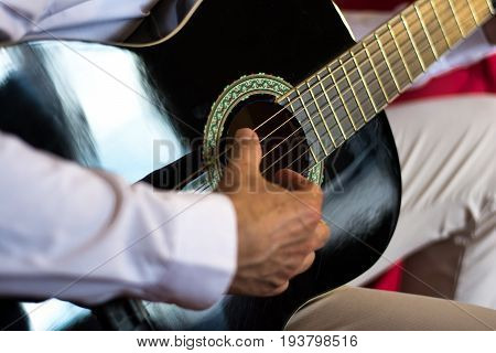 Closeup of a musician playing classical guitar